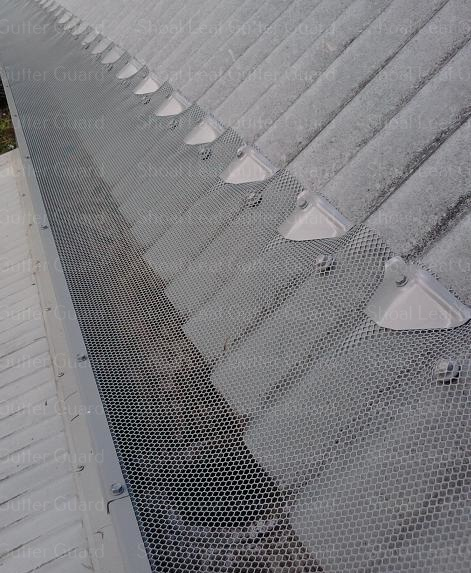 Steep pitch roof now protected with leaf guard - Metal gutter guard