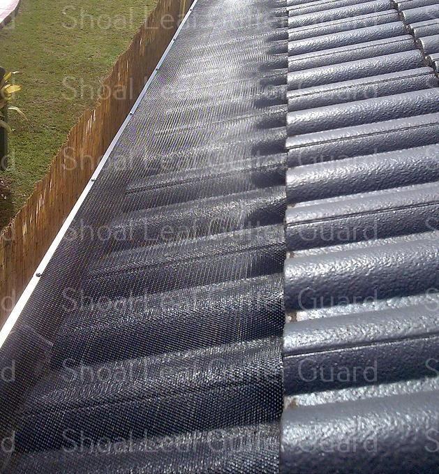 Leaf Guard to a black tile roof - Kiama Gutter Guard and Kiama Leaf Guard